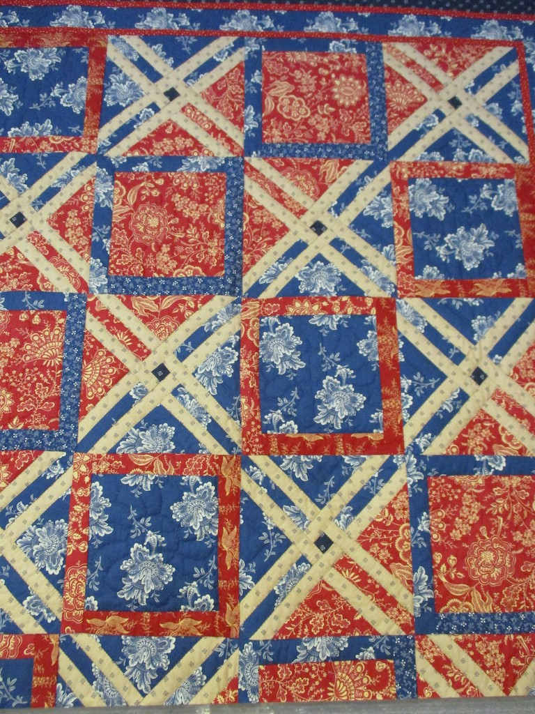 266, A SPLASH OF RED (signed and dated), 50x70, Pieced by Dorothy Crider, Quilted by Marie Eby