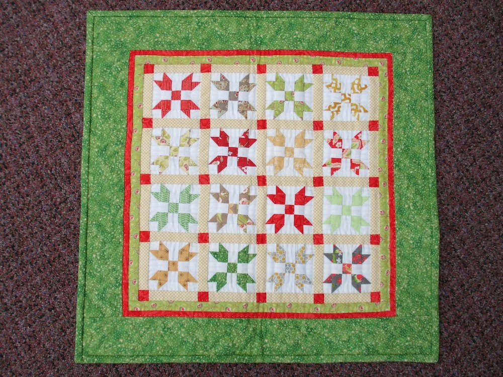 287, SPRINGTIME IN GROFFDALE, 19x19, Pieced by Ellen Ressler, Quilted by Wendy Witter, Donated by Quilter's Attic