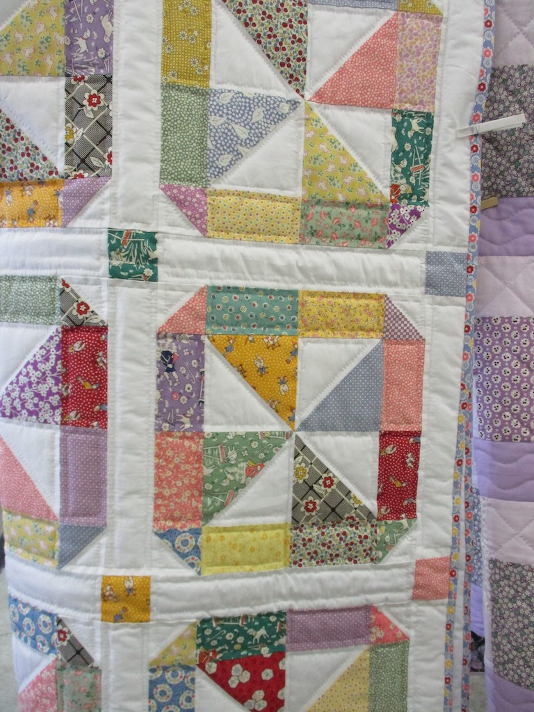 296, PINWHEEL (signed and dated), 44x60, Pieced by Marsha Williams, Quilted by The Cumberland Valley Relief Center