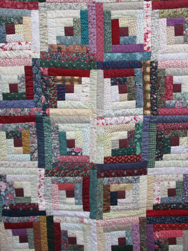 301, LOG CABIN, 44x60, Donated and Quilted by Ruth Hershey