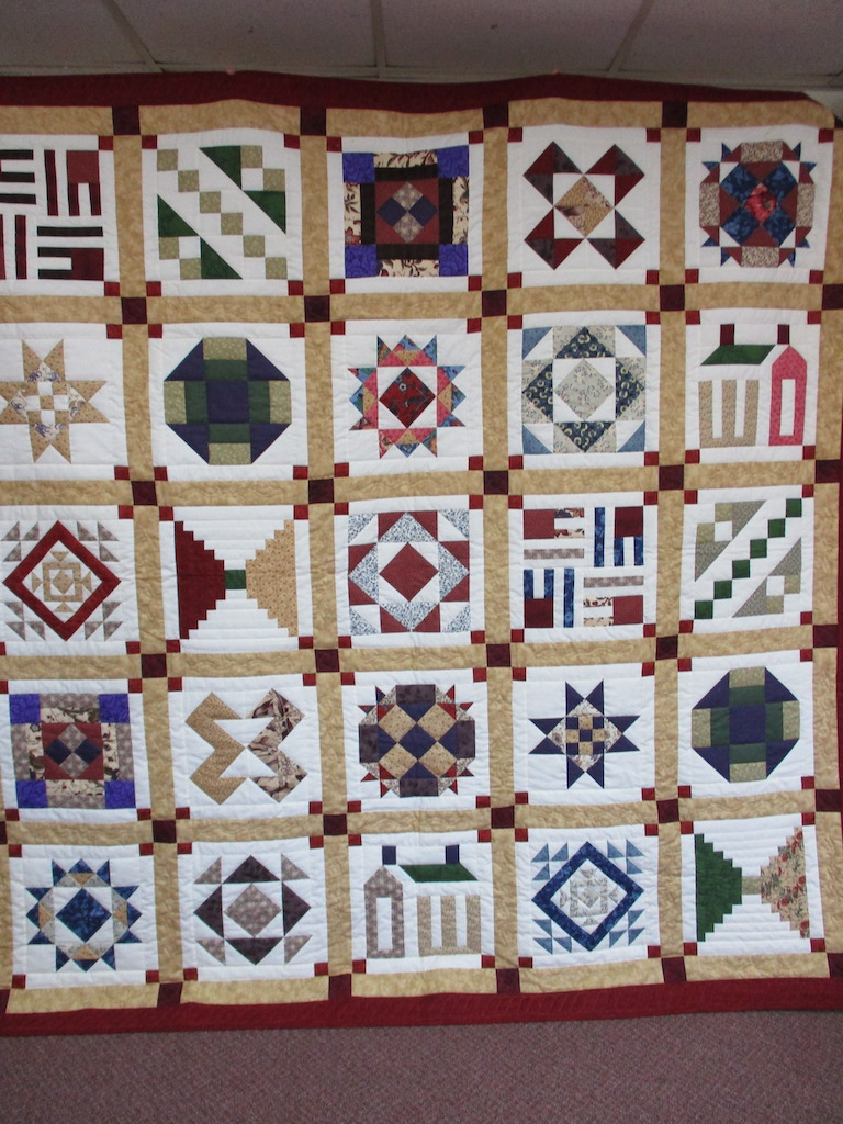 303, WOMEN'S VOICES SAMPLER, 94x94, Pieced and Donated by A friend of MCC, Quilted by MCC volunteers