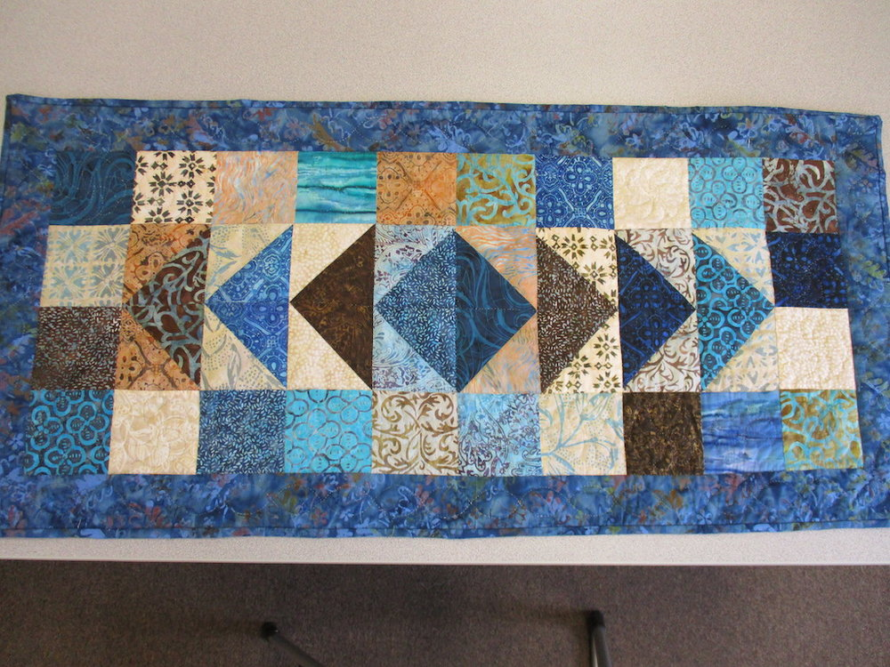 312, FLYING GEESE (signed and dated), 22x44, Pieced by Joan Norcross, Quilted by Marie Eby