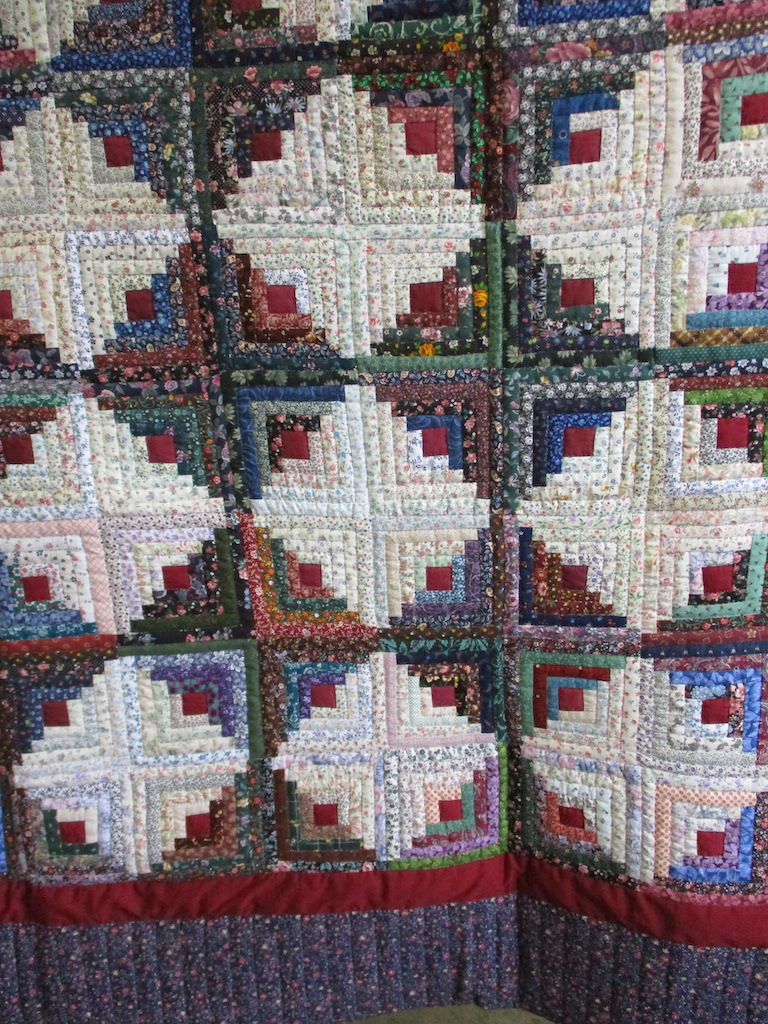 322, LOG CABIN` (signed and dated), 80x98, Pieced by Nancy Cordell, Quilted by The Cumberland Valley Relief Center