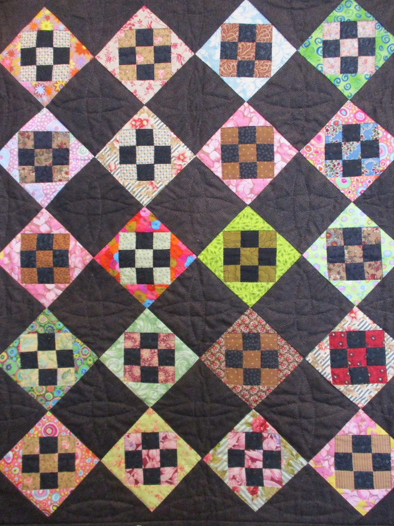 330, NINE PATCH SQUARE IN A SQUARE (signed and dated), 25x31, Pieced by Karen Manderson & Barbara Nelleman, Quilted by Fannie Frey