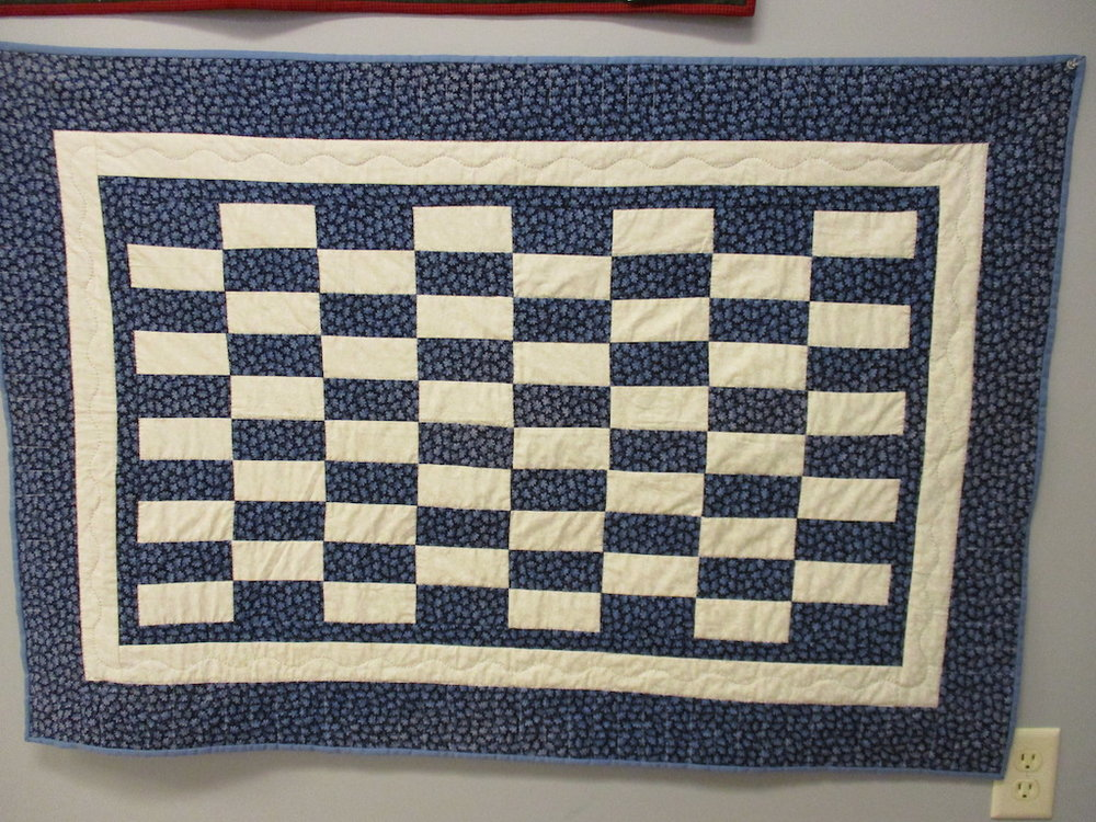 332, BLUE AND WHITE (signed and dated), 33x48, Pieced by Joan Norcross, Quilted by Marie Eby