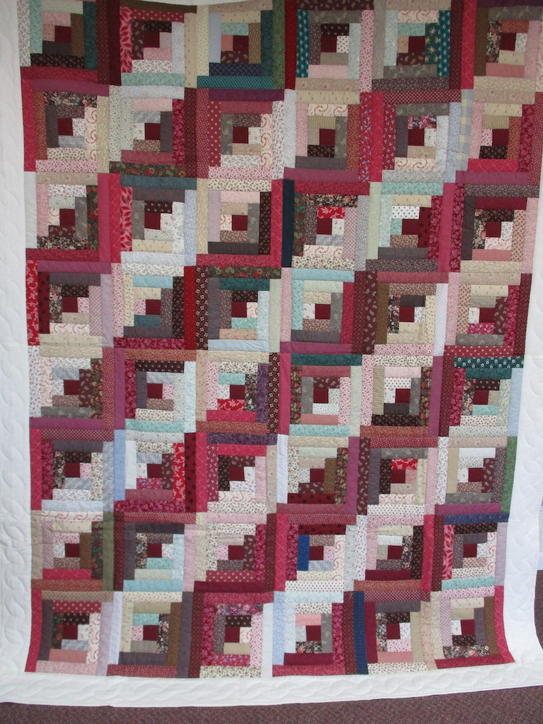 334, SCRAPPY LOG CABIN, 76x96, Quilted and Donated by Locust Grove Mennonite Church Ladies' Sewing Circle