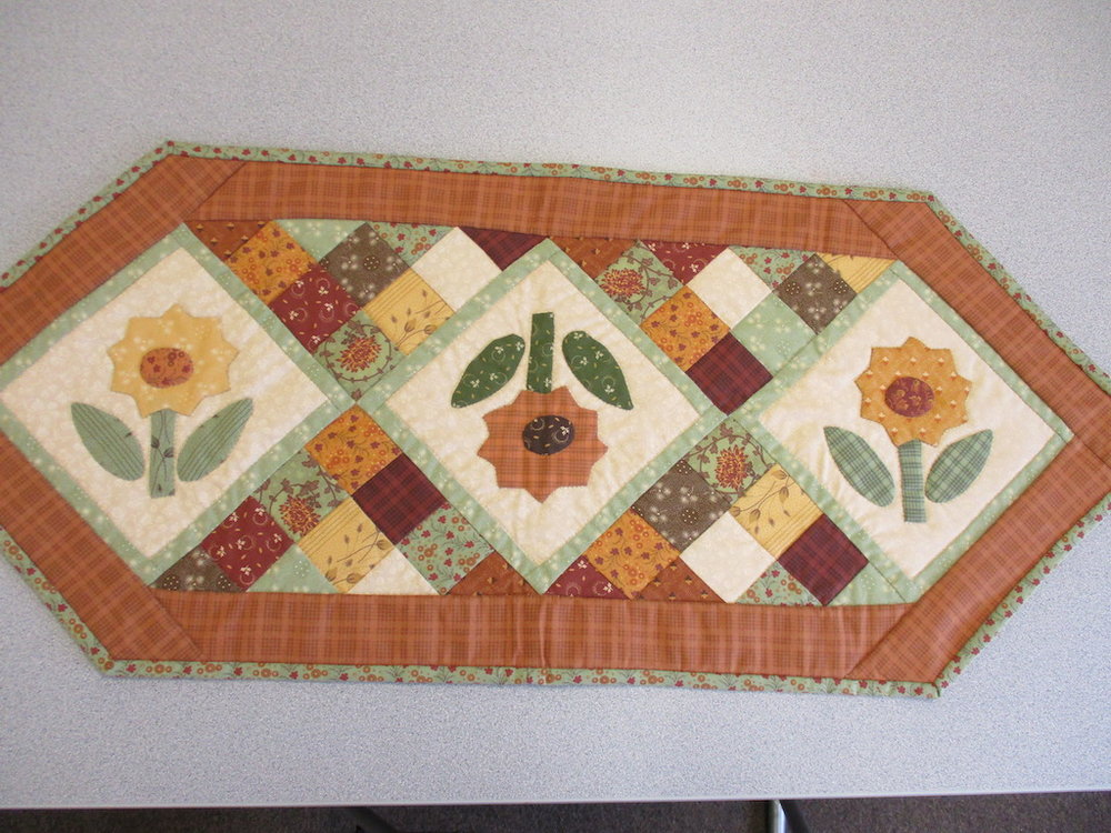 340, HOLIDAY HARVEST TABLE RUNNER (signed and dated), 15x39, Pieced by Dorothy Crider, Quilted by Marie Eby