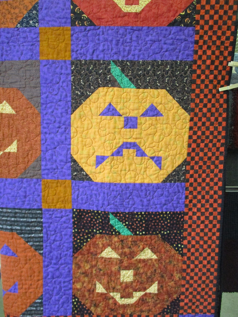 344, JACK-O-LANTERN (signed and dated), 54x70, Pieced and Machine quilted by Judith McLean