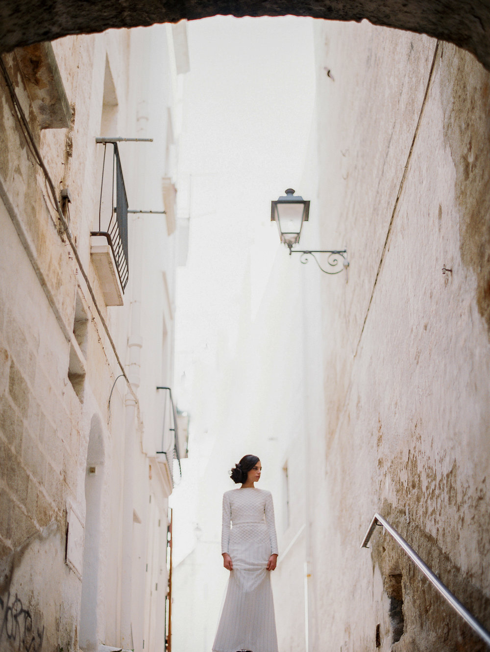 lauramurray-travel-destinationphotography-creativetravel-artists-filmphotography-unearthingtc-bride-walls-europe.jpg