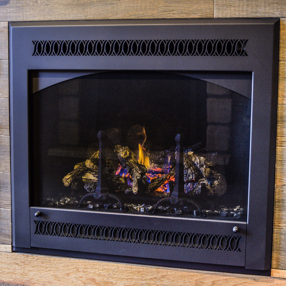 Fireplace X 864 TRV  - ‧ Direct Vent Gas Fireplace ‧ 31,000 BTU‧ Metropolitan Front‧ Black Enamel Fireback‧ Accent Lights‧ Wrought Iron Andirons‧ Wireless Wall Thermostat‧ Twin 90 CFM Convection ‧ Fans‧ Top or rear vent‧ Available in High Output model‧ Available as a See-Thru