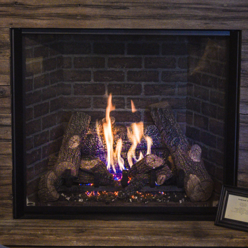 FireplaceX 4237 - ‧ Direct Vent Gas Fireplace - 60,000 BTU‧ Handmade Brick Firebox Panels‧ Clean Face Front - Black‧ High Definition Log Set‧ Full Function Green Smart Remote Control‧ Fan‧ Enormous 1554 square inch glass‧ Great heater‧ Impressive logset