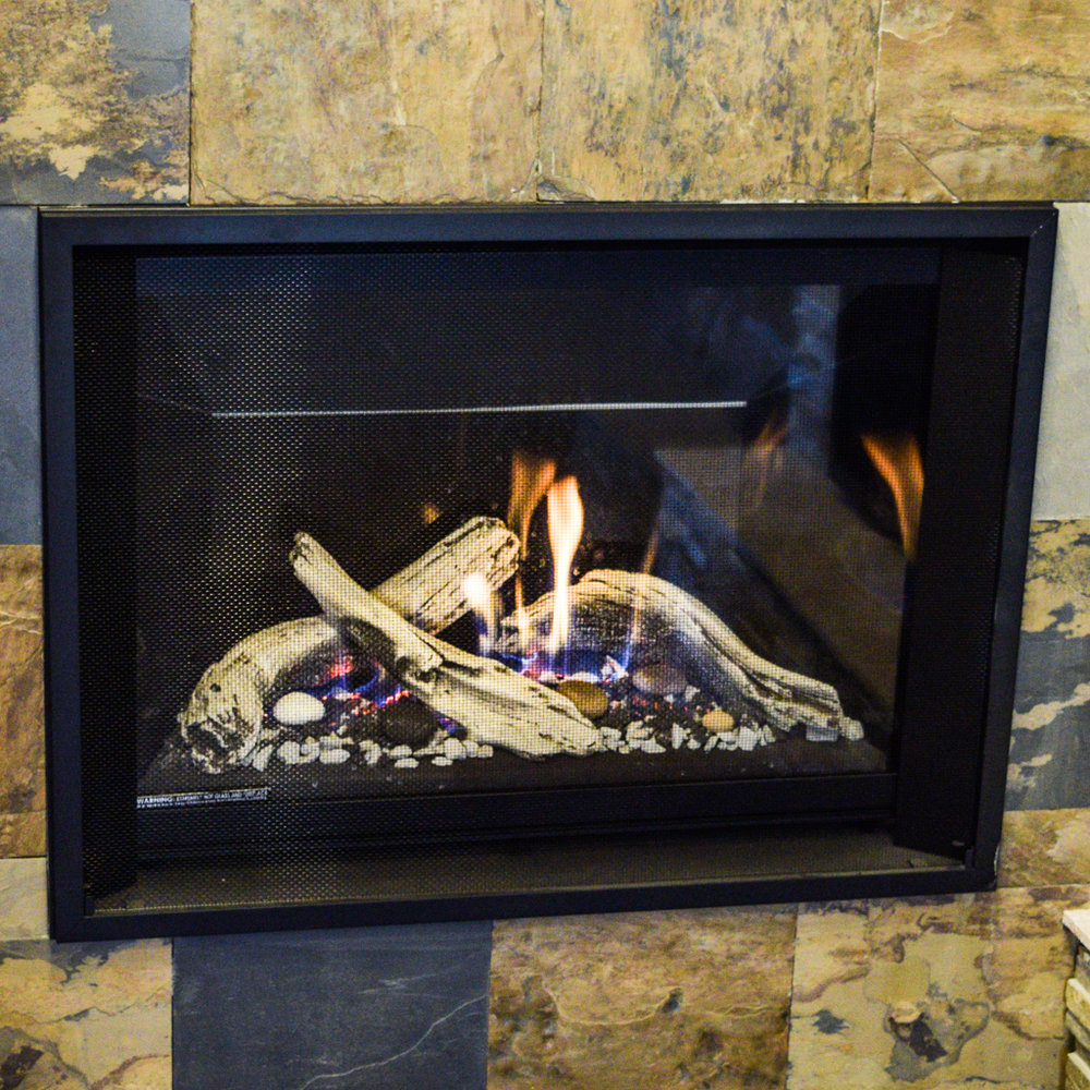"""Valor H5 - ‧ Direct Vent Gas Fireplace - 28,000 BTU‧ Reflective Glass Firebox Panels‧ 1"""" Fixed Framing Kit‧ Pebble Beach Driftwood kit‧ Heat Shift – 38"""" Plenum kit‧ Maxitrol Remote Control‧ Fan – Not included‧ Strong heater‧ Multiple firebox media options‧ Modest choice of Fronts"""