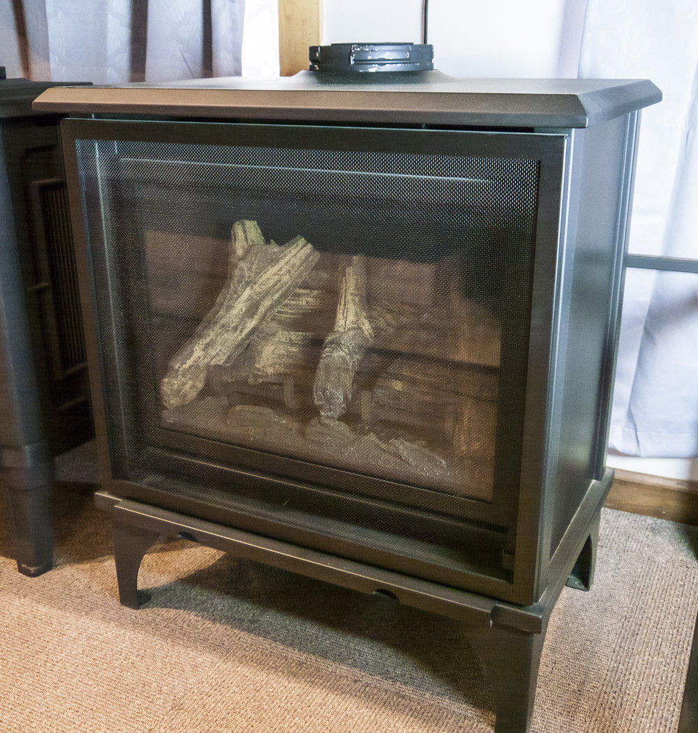 Kozy Heat Birchwood - ‧ Direct Vent Gas Stove - 32,500 BTU‧ Refractory Panels – Not included‧ Full Rectangle Screen Front‧ Steel Body w/ Traditional Legs‧ Premium Fiber Logs‧ Millivolt Valve‧ Fan – Not Included as shown; optional‧ Value Line‧ Millivolt or ProFlame 2 controls