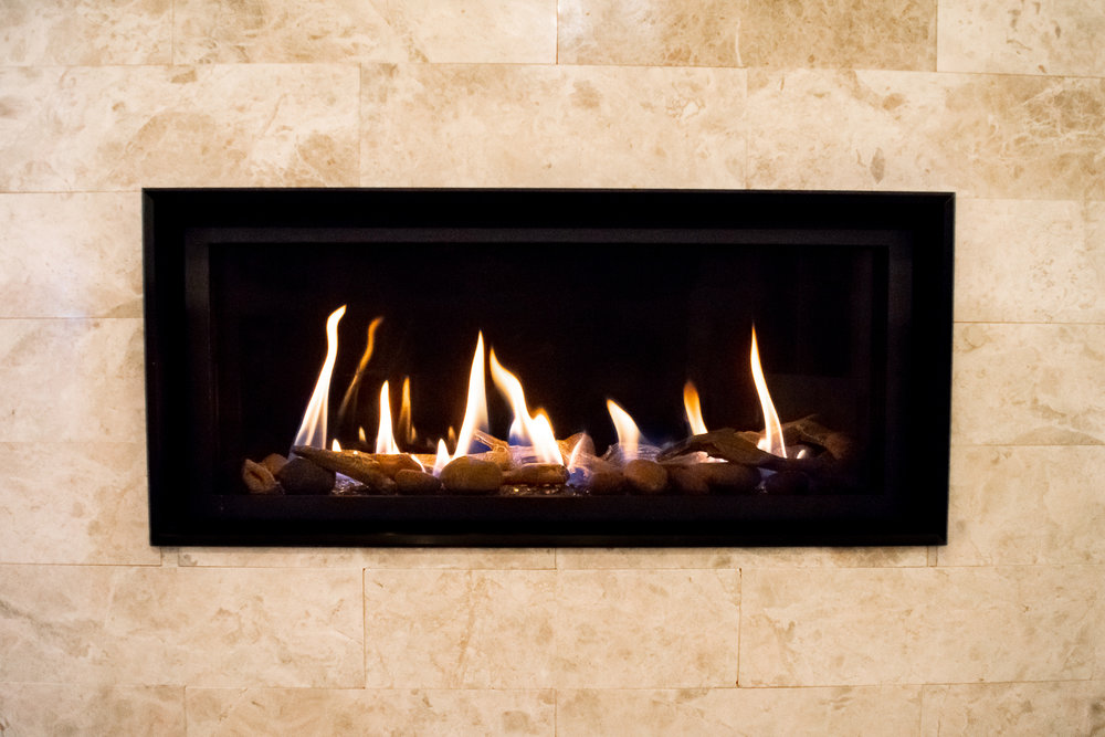 FireplaceX 3615 - ‧ Direct Vent Gas Fireplace - 33,000 BTU‧ Black Porcelain Enamel Fireback‧ Tile Trim Kit‧ Driftwood Twigs and Stones Fyre-Art‧ Black Glass‧ Proflame2 Full Function Remote Control‧ Fan‧ Our very best-selling fireplace‧ Choice of glass – driftwood – logs‧ Perfect for large bedrooms – family rooms – office‧ Most Popular Linear Fireplace