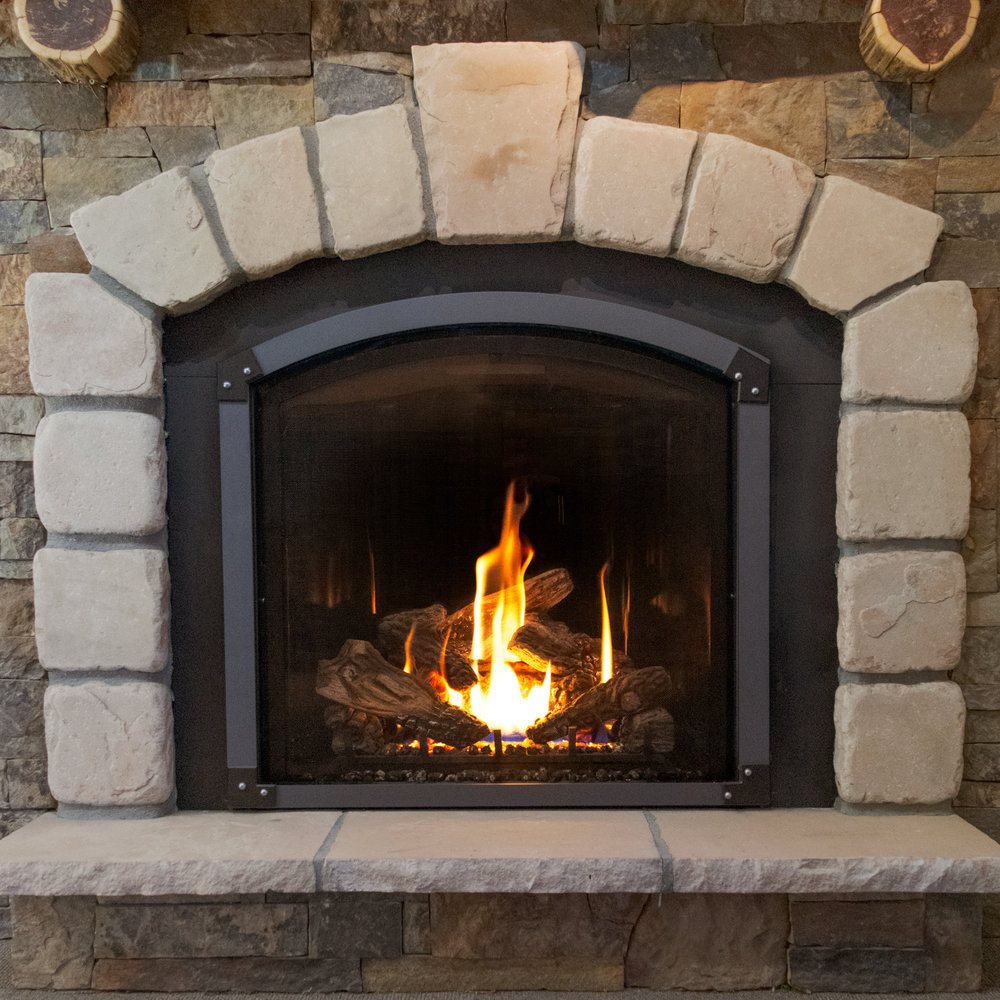 Mendota FV-41 Arch - ‧ Direct Vent Gas Fireplace - 40,000 BTU‧ Panoramic Black Porcelain Reflective Firebox Liner‧ Grace Wide Arch Front - Vintage Iron‧ Grace Wide Arch Accent Corners - Black, with Chrome Rivets‧ Premium Fiber Oak Logs‧ Proflame2 Full Function Remote Control‧ Fan‧ Terrific Heater & Superior Quality‧ Large selection of Fronts & Colors‧ Most Popular Gas Fireplace