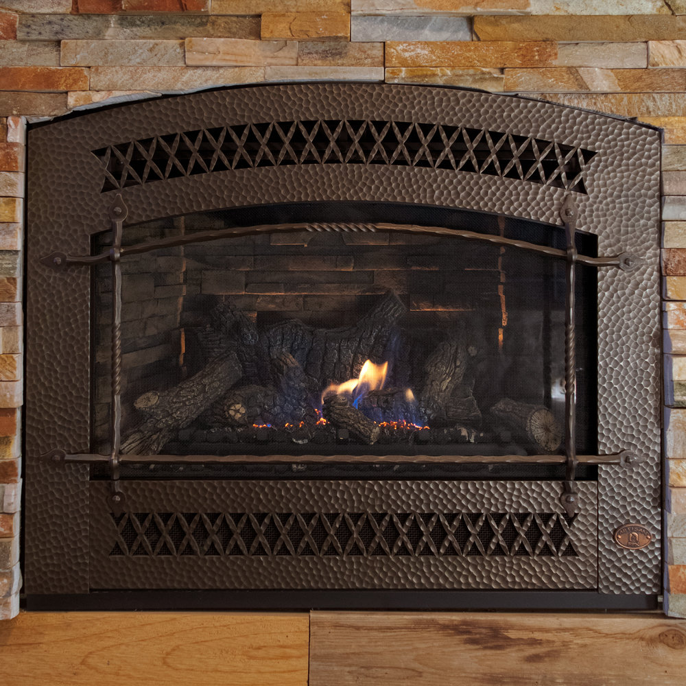FireplaceX 564 HO - ‧ Direct Vent Gas Fireplace - 35,000 BTU‧ Ledgestone Firebox Panels‧ Artisan Front - Bronze‧ Emberfyre Burner with Logs‧ Green Smart Remote Control‧ Fan‧ Strong heater‧ Stylish hammered Artisan Front‧ Highly reliable