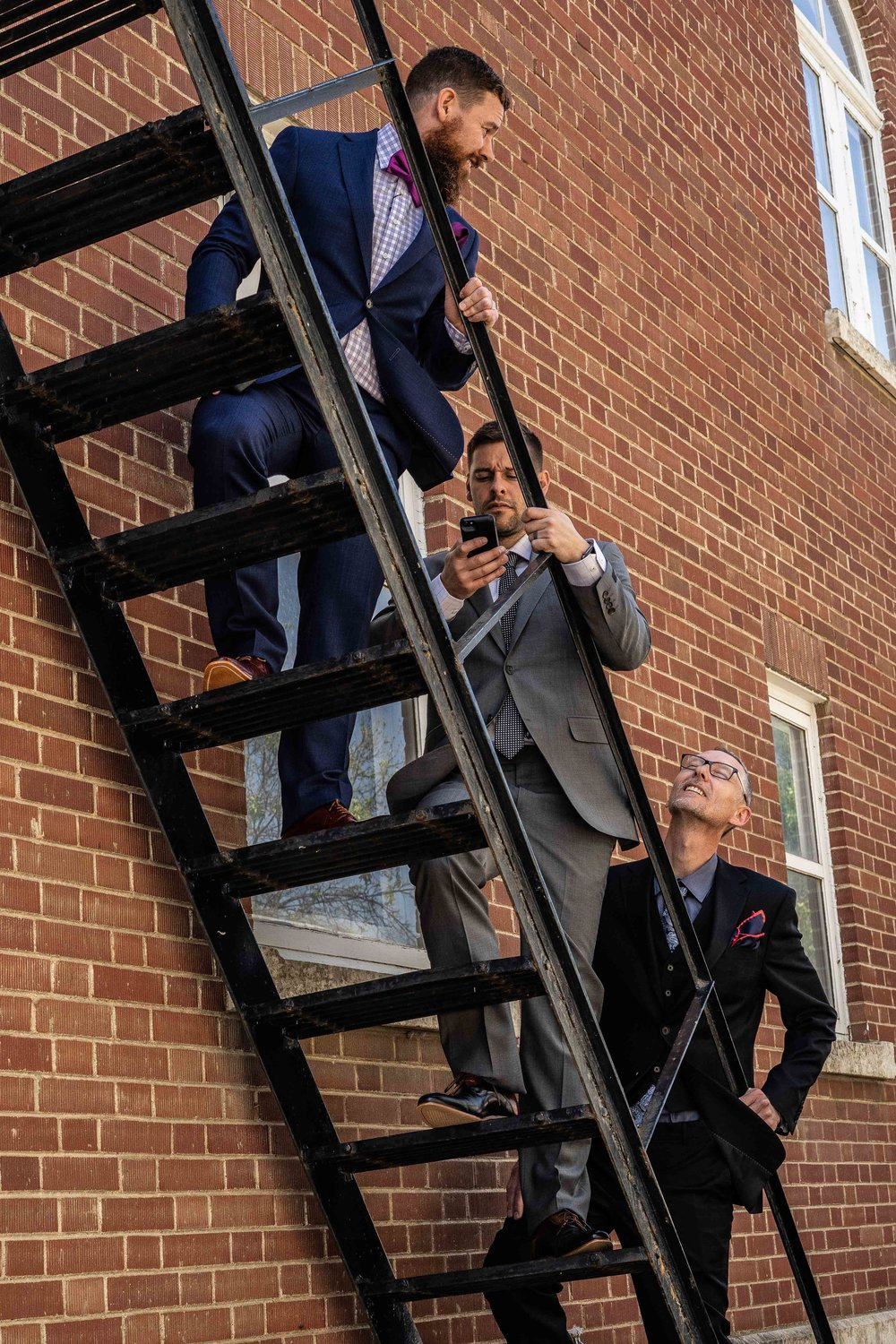 red guys up fire escape.jpg
