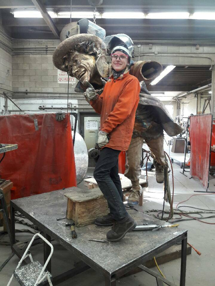 Julie poses with Brigette Mongeon's Mad Hatter Sculpture at Shidoni Foundry, Its now located in Evelyn's Park, Bellaire, Texas.