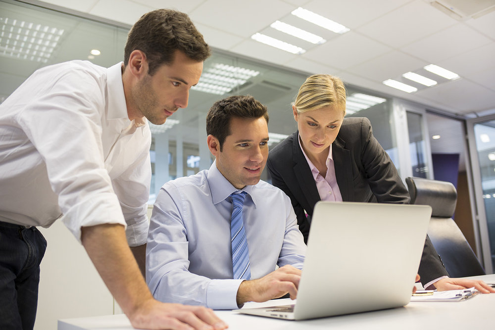 Business team looking at computer