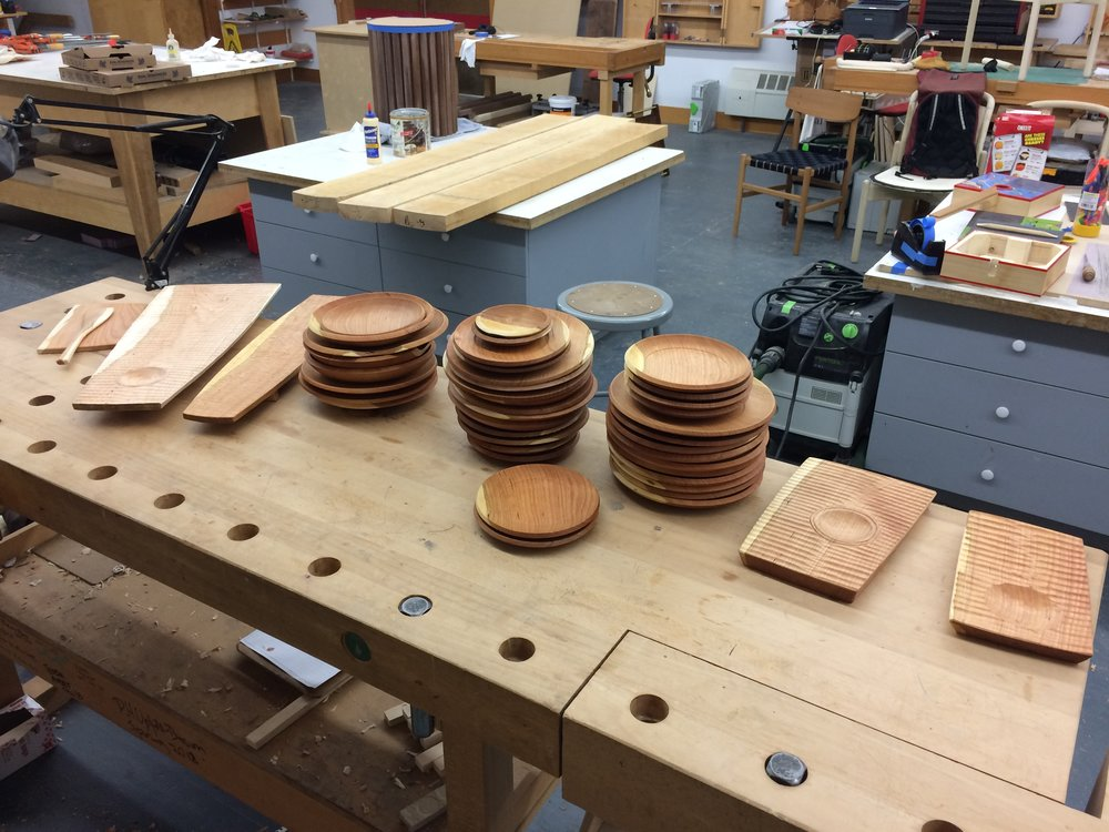 Here is almost everything I made from one generous cherry log: a cutting board, spatula, four platters, and 50+ plates. I still have additional blanks waiting to take shape.