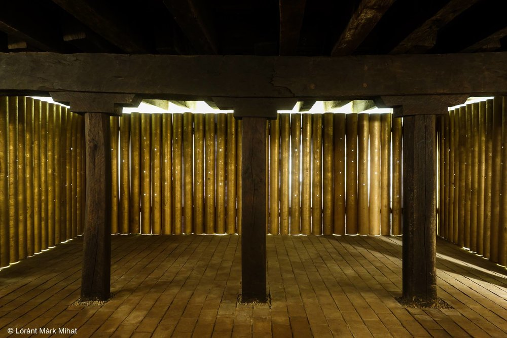 the illuminated spatial installation in the cellar