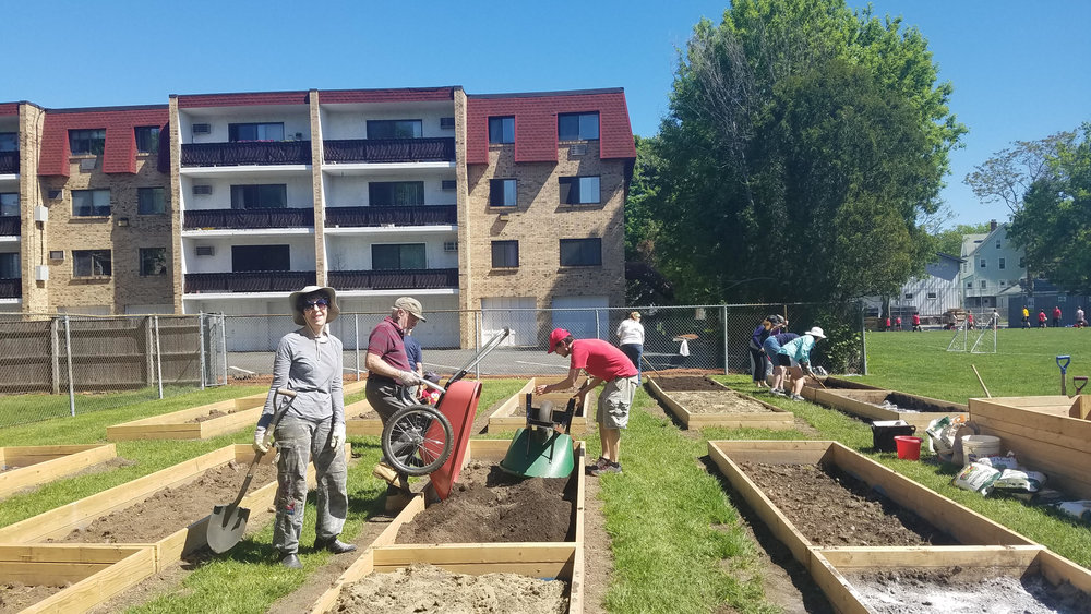 Community Garden - Adding soil to the plots.jpg