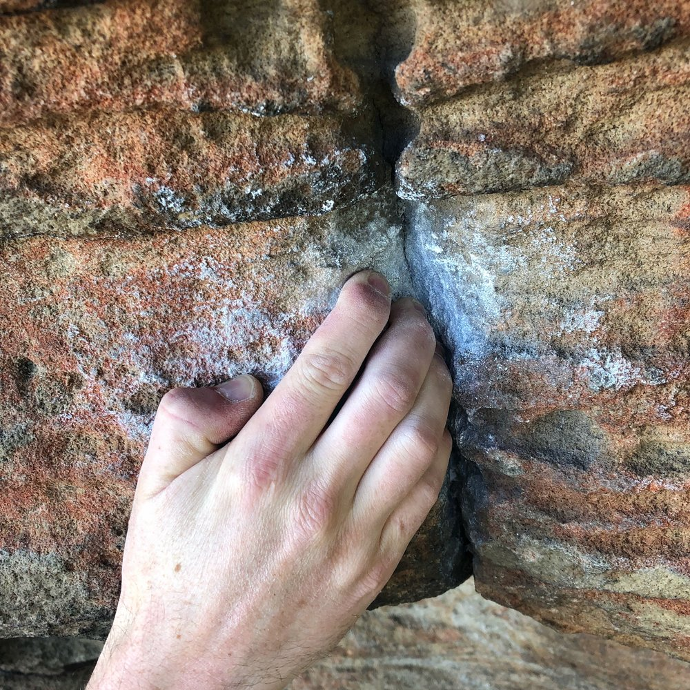 Pull tight on this small crack to kick off the un-named (but popular) V2 at the Left Hand Side of Queens Park.