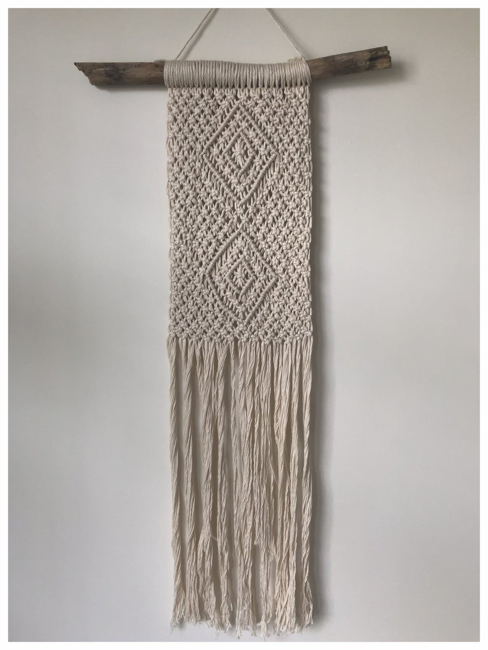 Handmade macrame wall hanging art with drift wood and fringe detail in soft cotton yarn £90