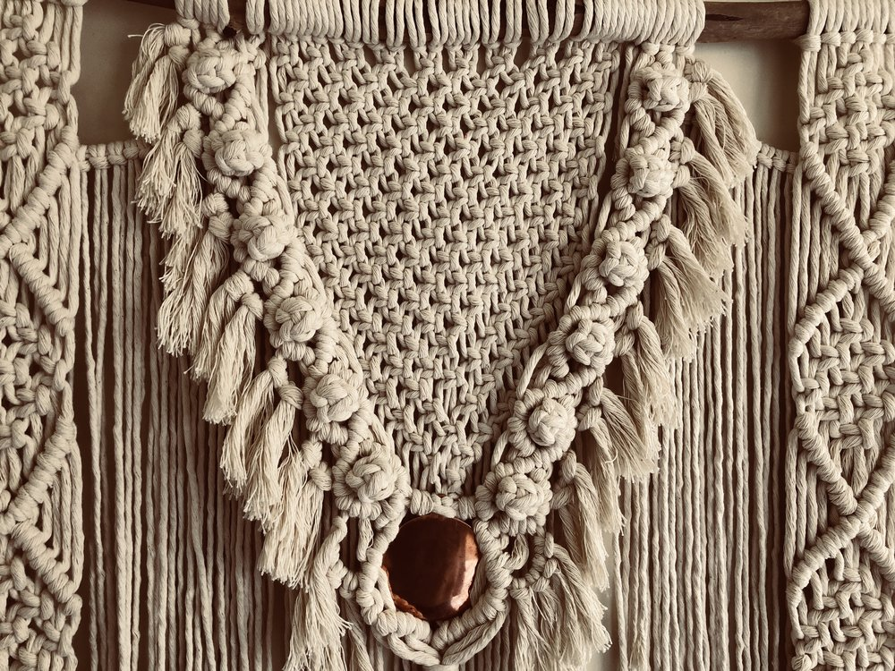 All our macrame piece are hand knotted using  natural cotton yarn and detailing sourced from California