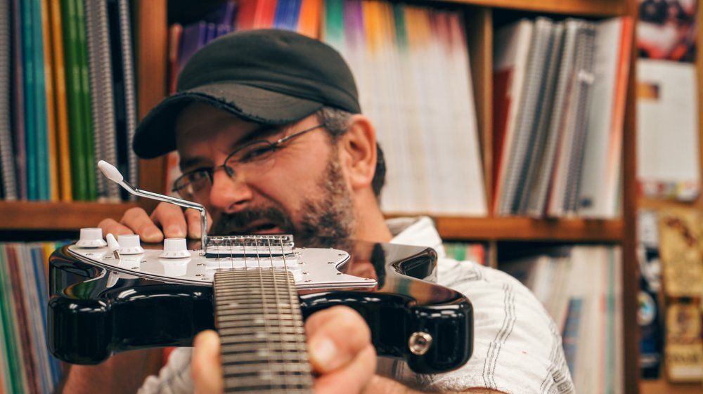 kyle-holding-guitar.JPG