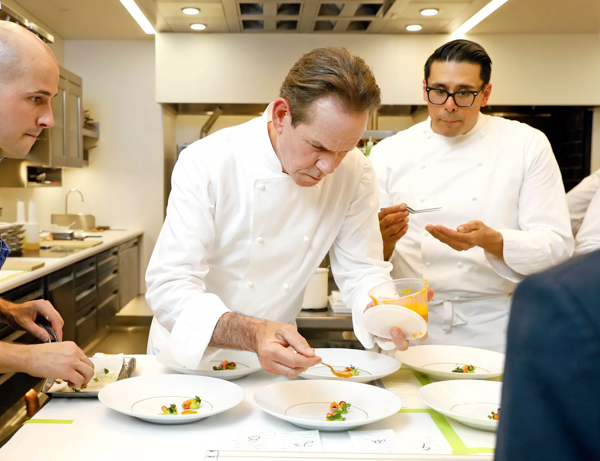 Photo of Chef Thomas Keller with his staff