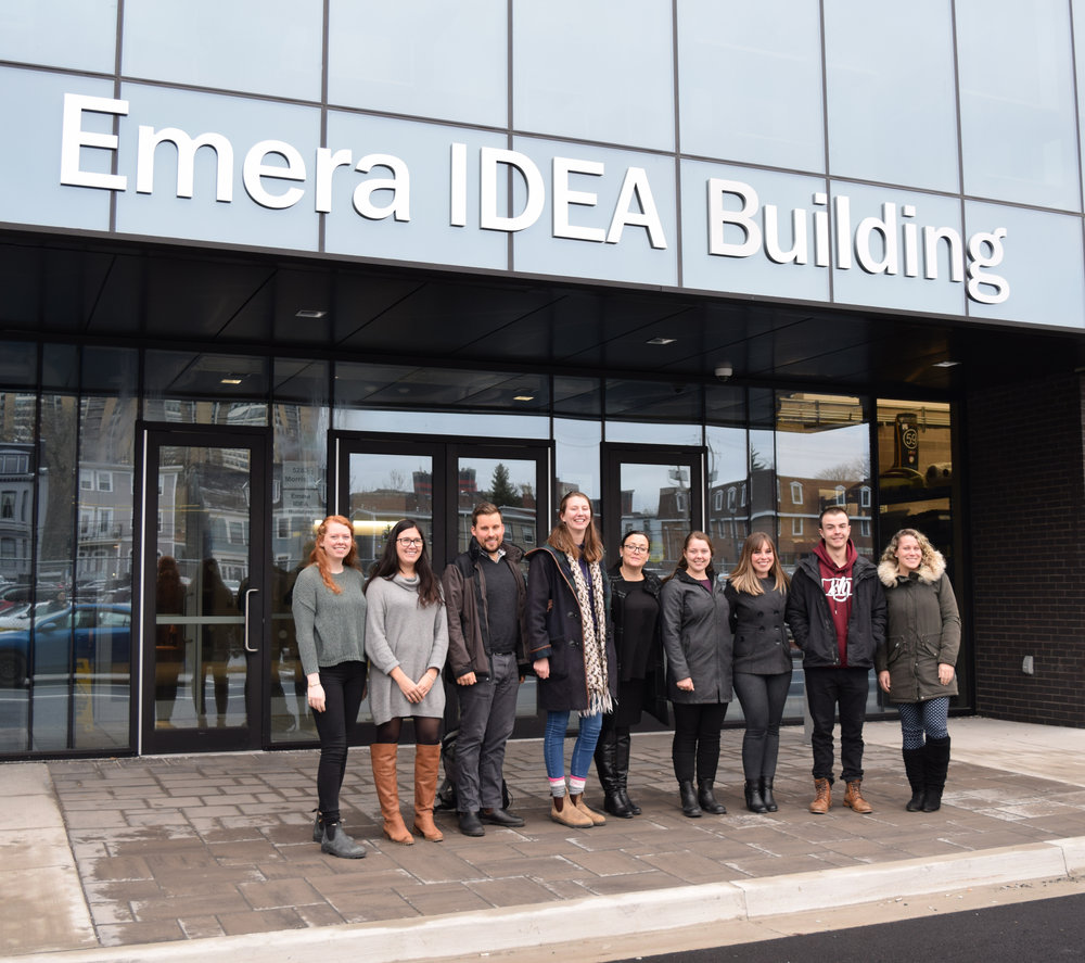 Trainees and presenters in front of the Emera IDEA building (l-r: Aidan Van Heyst, Nicole Bell, David Foster, Baillie Holmes, Stephanie Coady (Emera), Caitlin McCavour, Mary Jenkins (Emera), Mike Hamilton, and Heather McGuire).