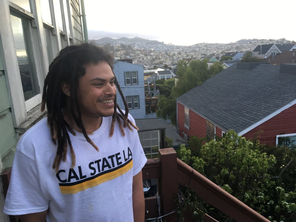 Will Clark on his balcony in his home in San Francisco. He's been living with his resource family, the Huson's, for the past year. Photo credit: Liza Veale for 70 Million.