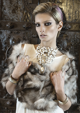 FRIDA | Fine Jewellery. Emma Lamb modeling a custom designed pearl neck sculpture, and 18kt yellow gold and sterling silver cuffs.jpg