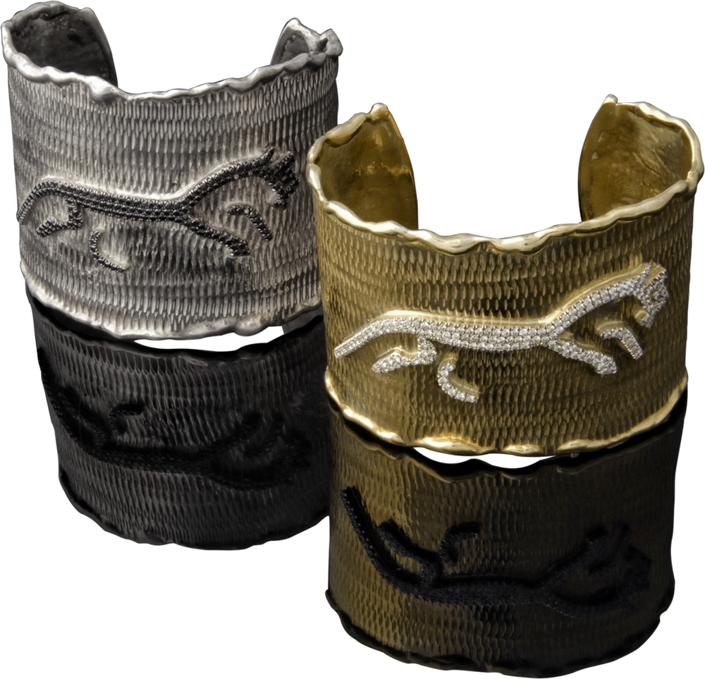 FRIDA   Fine Jewellery. Caribou Collection, Spirit cuffs. Custom designed sterling silver 18kt yellow gold cuffs with diamonds set in 18kt white gold. Inspired by the Uffington White Horse.png