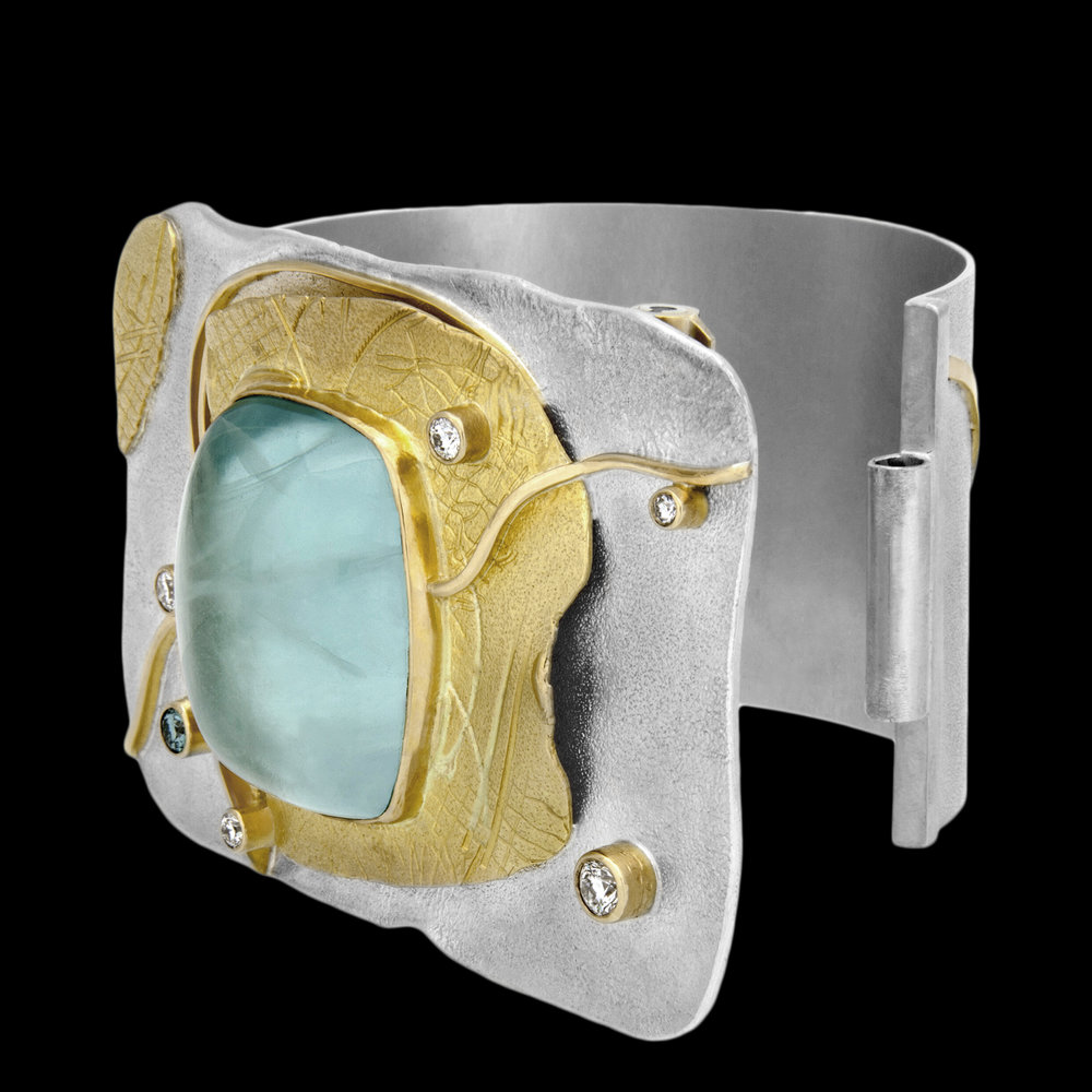 FRIDA | Fine Jewellery. Shield™ Collection, Aquamarine Shackle cuff. Custom designed cuff in sterling silver and 18kt yellow gold set with a cabochon-cut aquamarine and brilliant-cut diamonds.