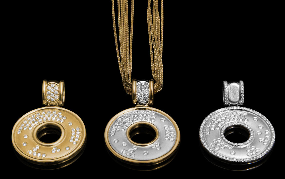 FRIDA | Fine Jewellery. Strata™ Collection. Pendants in high polished and finely textured 18kt yellow and white gold set with scattered brilliant-cut diamonds.