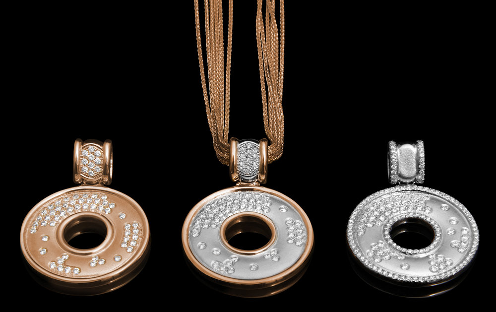 FRIDA   Fine Jewellery. Strata™ Collection. Pendants in high polished and finely textured 18kt pink and white gold set with scattered brilliant-cut diamonds.