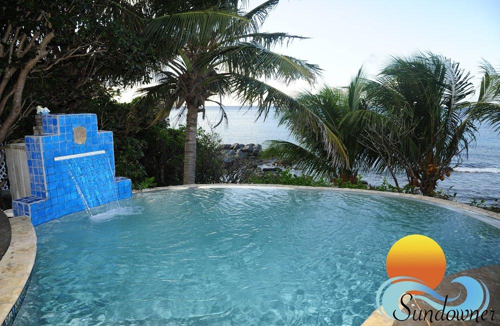 The infinity edge pool of Sundowner beachfront villa.