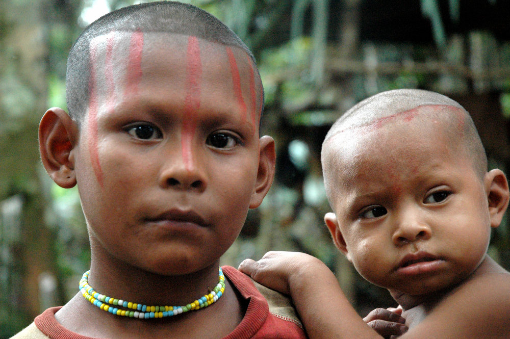 Nukak mother and child in Guaviare, Colombia. The Nukak are one of more than 30 indigenous peoples in Colombia at risk of 'extermination.' Credit: David Hill/Survival