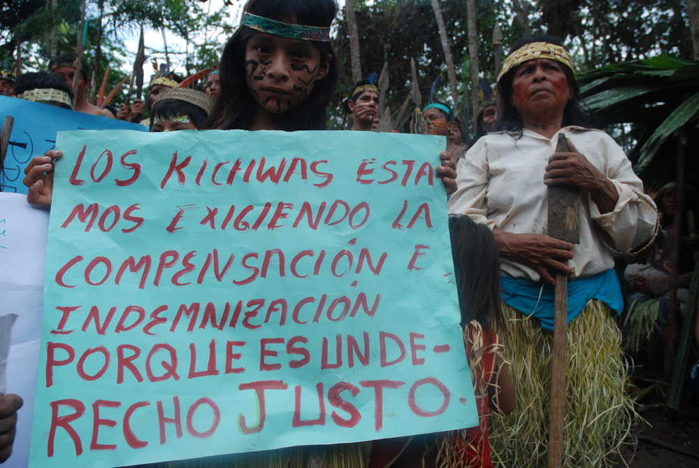 Kichwa men, women and children along the River Tigre, Peru protesting oil contamination. Companies have operated in their territories for over four decades. Credit: David Hill