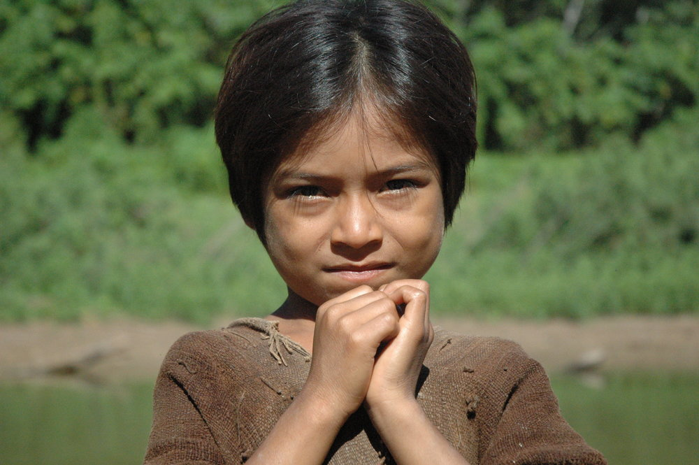 Ashéninka boy along the River Yurúa, Peru. The Ashéninka are one of more than 60 indigenous peoples in Peru. Credit: David Hill/Survival