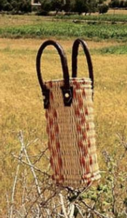Wine Holder by  Tigmi Bags  of the Anou from Morocco.   Click to Shop