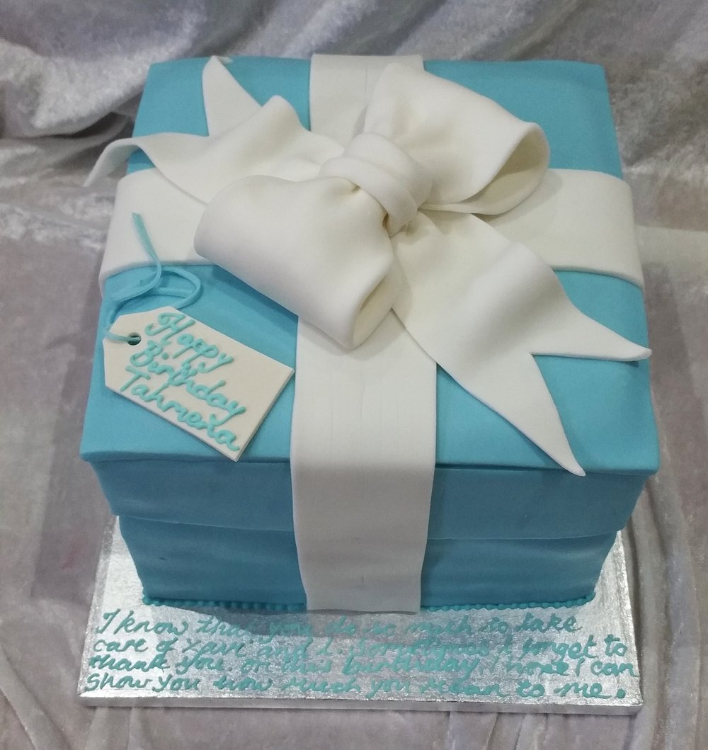 Pretty and cute - This lovely present cake was made to look like a present.  Double height and full of delicious sponge cake.