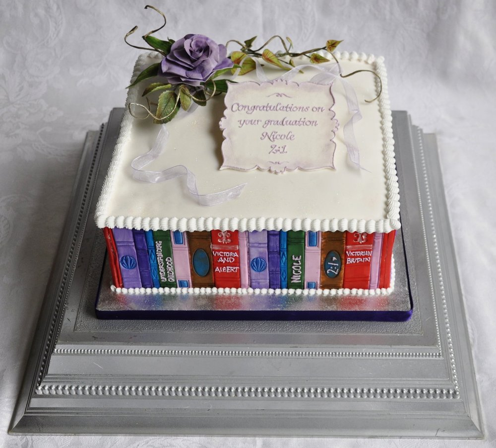 Graduation cake - Each book has been hand made and hand painted, and a selection piped with the names of books that have been studied and enjoyed for three or four years!  The keepsake plaque and delicate sugar flower arrangement makes it memorable in so many ways.