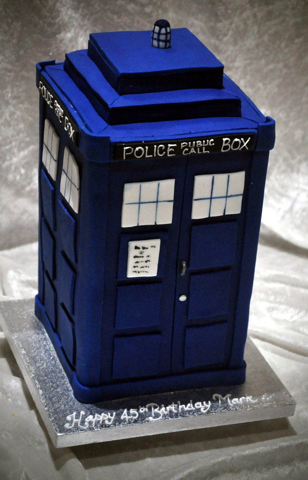 Tardis cake - Bigger on the inside than outside is our hand made, wonderful Tardis cake!  Made for Dr Who enthusiast, Mark, who was delighted, it is a cake that will be memorable in any time and space!