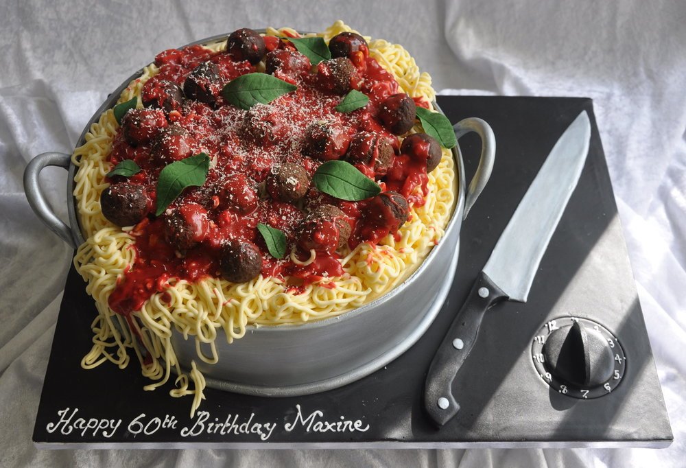 Spaghetti cake - Yummy!  So good it could be the real thing…  A delicious fresh cake, made to look like a massive pot of hot, steamy, meaty spaghetti and meatballs, garnished with parmesan cheese and fresh basil leaves.  Made for an enthusiastic Italian cook, our fun novelty cake is guaranteed to please everyone!