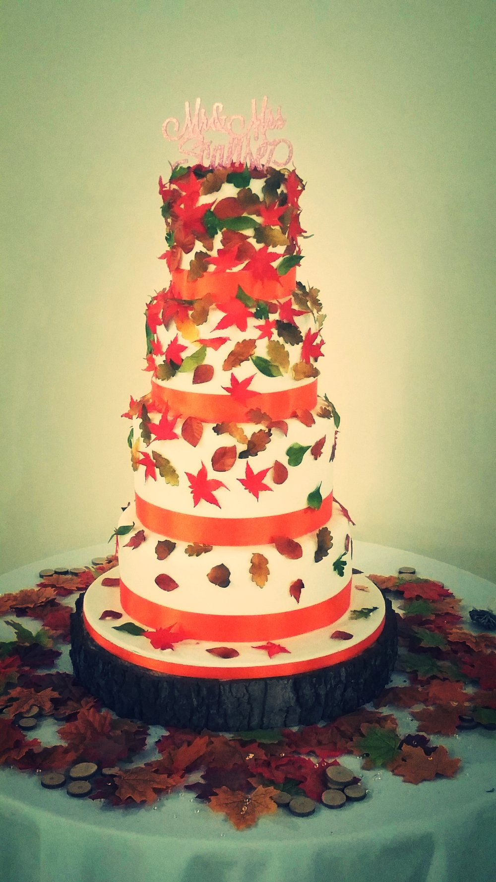 Autumn cascade - Holly and Sal's delicious wedding cake, with falling sugar leaves in golds, and greens are perfect for their Autumn wedding