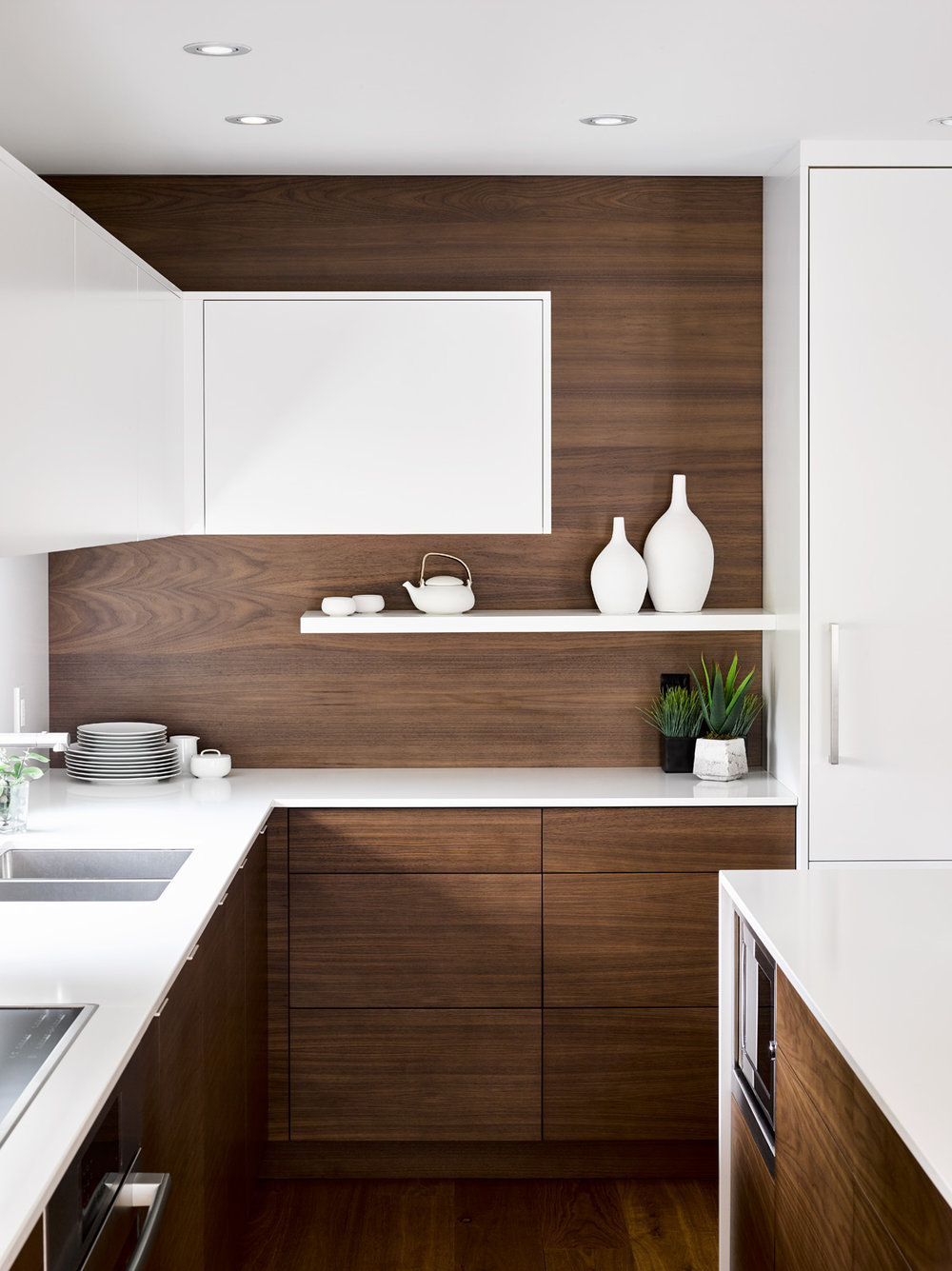 White Cabinetry with Walnut Backsplash