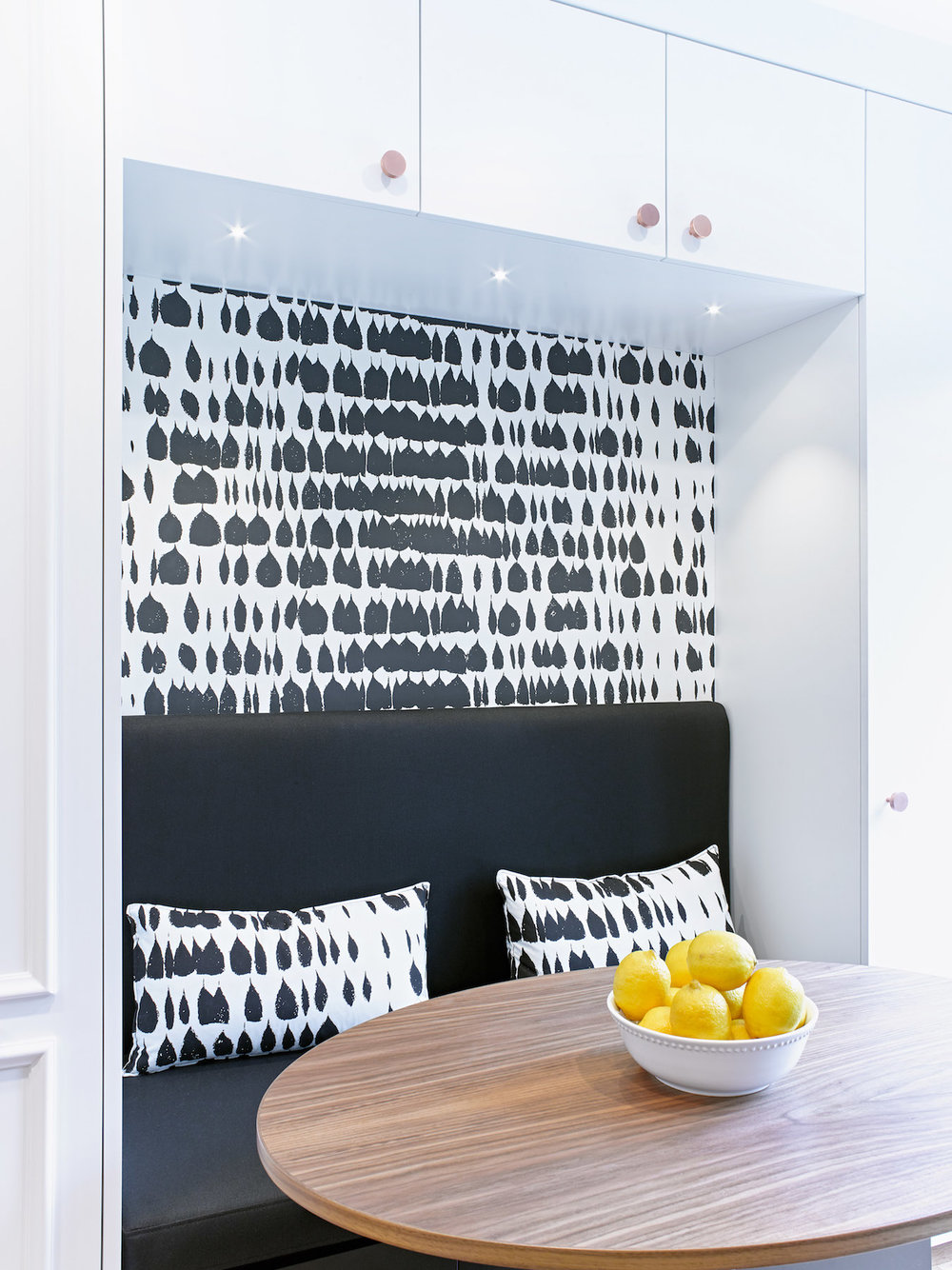 Built in Banquette with black and white wall paper